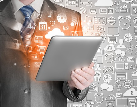digitally concepts: Business man using tablet PC