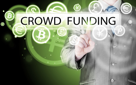 pushes: Businessman pushes virtual crowd funding button