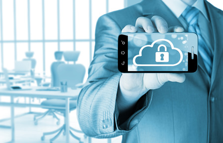 concep: Man holds smart phone with cloud security concep