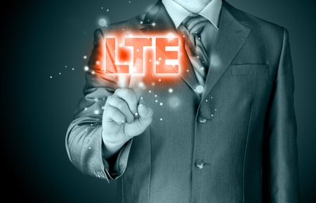 lte: businessman is pushing his finger on lte button