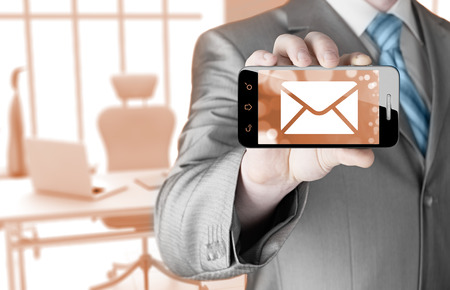 new message: man holding smartphone with one new message on a screen