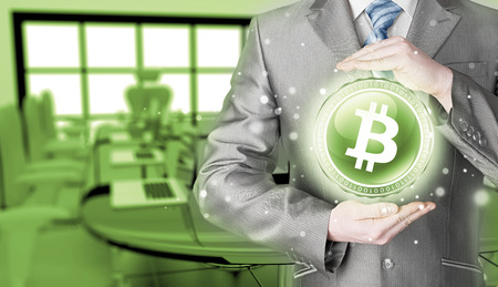 net trade: Businessman with protective gesture bitcoins Stock Photo