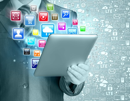 Business man use tablet pc with colorful application icons Stock Photo