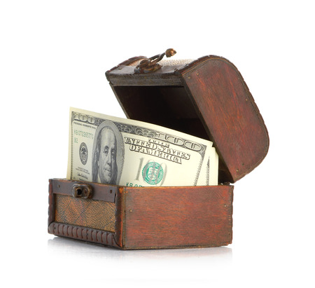 bankroll: Dollar-bills in the old wooden treasure chest Stock Photo