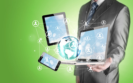 using tablet: Business man using tablet PC and smartphone social connection Stock Photo