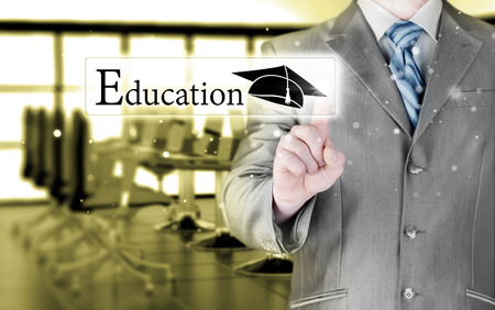 e systems: business man pointing education concept Stock Photo
