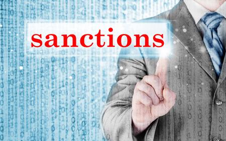 international crisis: businessman pressing sanctions button on virtual screens