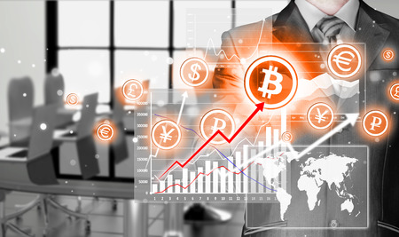 net trade: Choosing bitcoins, businessman pressing touch screen button.