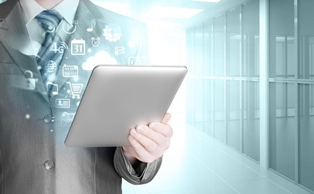 using tablet: Business man using tablet PC in office