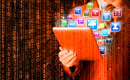 pda: Business man use tablet pc with colorful application icons Stock Photo