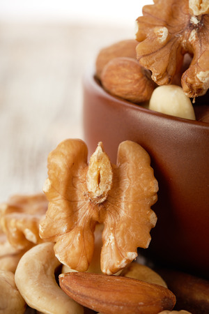 Mix nuts  on wooden background photo