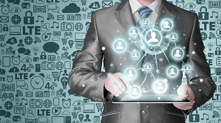 using tablet: Business man using tablet PC social connection Stock Photo