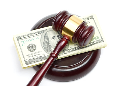 gavel: Law gavel on a stack of American money. Stock Photo
