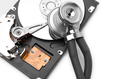 HDD with stethoscope on white