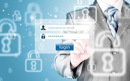username: Businessman holding login and password menu Stock Photo