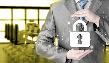 whistleblower: businessman in lock security protection concept Stock Photo