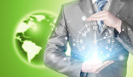punctual: businessman holding clock against illustration background
