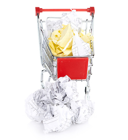 wastebasket: Recylcing concept with crumpled paper and shopping cart