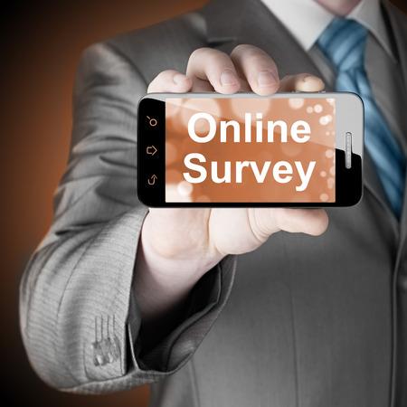online survey: Businessman showing business concept on smartphone  - Online Survey Stock Photo