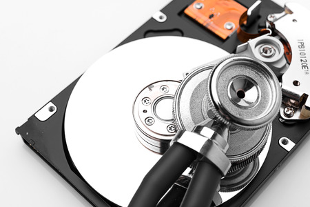 hard disk drive: stethoscope on the hard disk drive over white