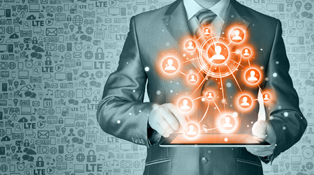 digitally concepts: Business man using tablet PC social connection Stock Photo