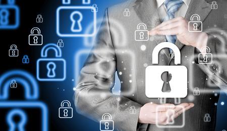 company secrets: lock security businessman protect concept