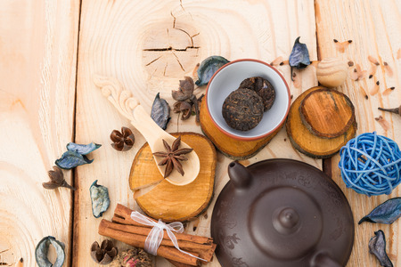 drink tea: dry tea leaves cinnamon and on wooden background