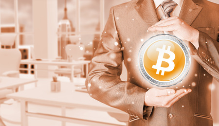 e cash: Businessman with protective gesture bitcoins Stock Photo