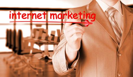 adwords: business man writing internet marketing Stock Photo