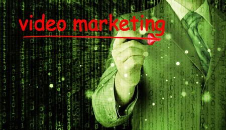 business man writing Video Marketing photo