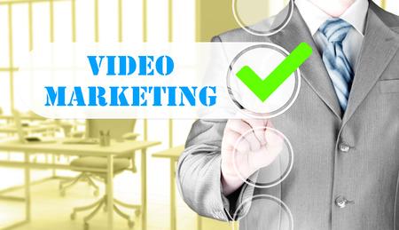 business man pressing checkbox Video Marketing photo