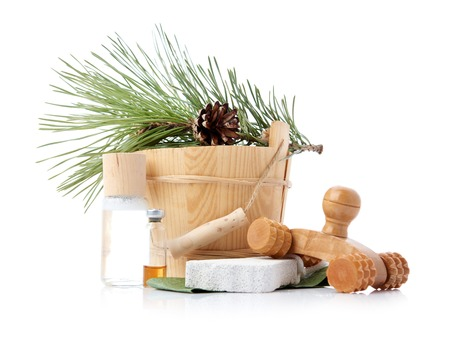 finland sauna: Wooden bucket with ladle for the sauna and stack of clean towels