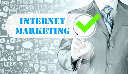 checkbox: business man pressing checkbox  internet marketing Stock Photo