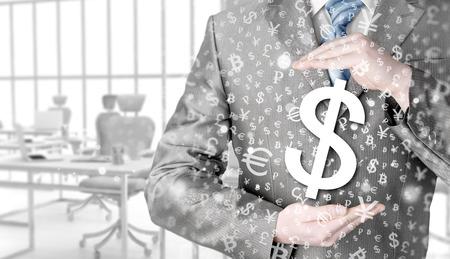 money concept: businessman protecting dollar symbol Stock Photo