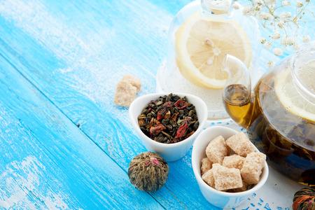 barbarum: Ripe lemon, cinnamon and fruit drink in glass teapot on wooden background