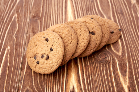 chocolate chip cookie: oat cookies on wooden table