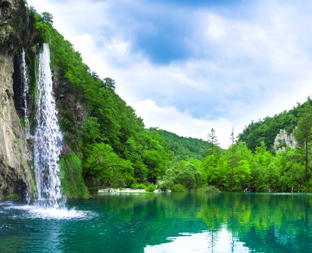 waterfall in mountain forest Stock Photo