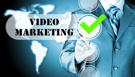 checkbox: business man pressing checkbox Video Marketing