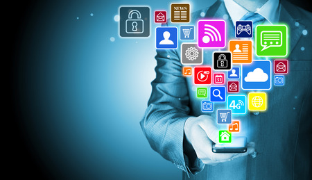 business media: Business man using smart phone with social media icon set Stock Photo