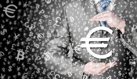 euro symbol: businessman protecting euro symbol Stock Photo