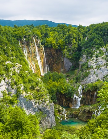 waterfall: waterfall in mountain forest Stock Photo