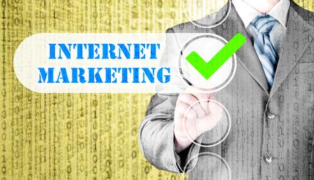 adwords: business man pressing checkbox  internet marketing Stock Photo