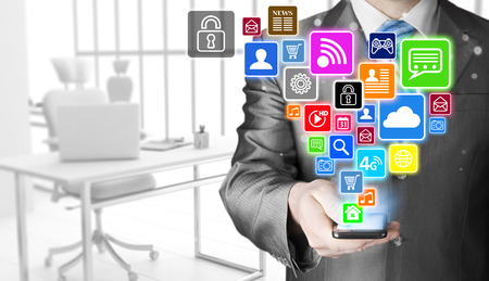 business phone: Business man using smart phone with social media icon set Stock Photo