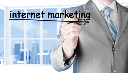 business man writing internet marketing Stock Photo