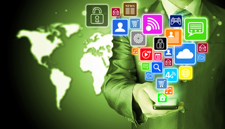 phone icon: Business man using smart phone with social media icon set Stock Photo