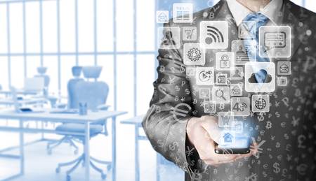 using smart phone: Business man using smart phone with social media icon set Stock Photo