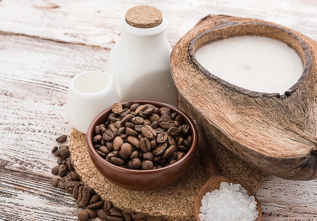 nature backgrounds: coffee beans, Spa stuff with candles in coconut