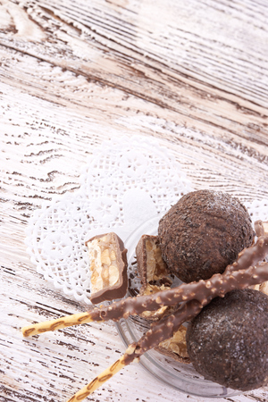 butter icing: Cupcake with chocolate on wooden background Stock Photo