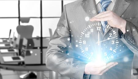 Image of businessman holding clock against illustration background