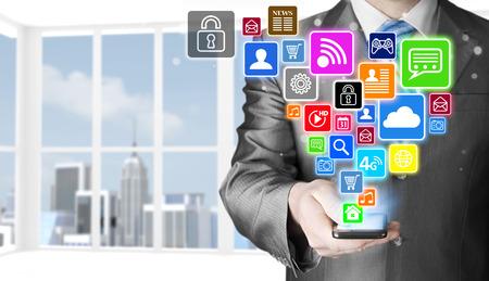 social media icon set: Business man using smart phone with social media icon set Stock Photo